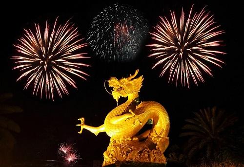 Golden gragon statue with fireworks, Phuket Thailand