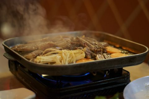 A Korean restaurant offering barbecue will satisfy the fans of barbecue.